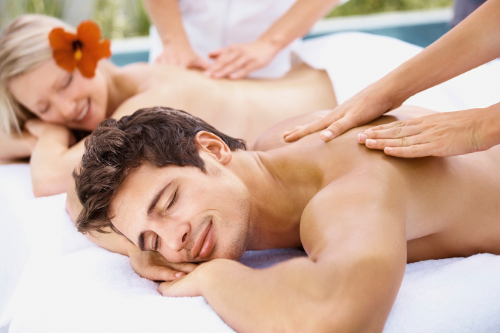 Rejuvenation - Couple enjoying a body massage at the spa